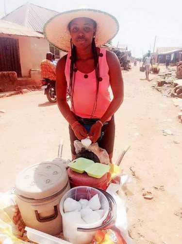 Graduate Who Sells Food With A Wheelbarrow Reveals She Makes More Than Paidwork