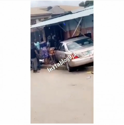 Learner Loses Control Of Her Car, Traps A Lady In Front Of Her Shop In Lagos
