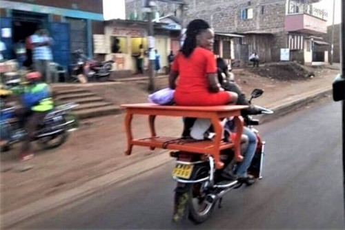 A Lady Sat On A Table On A Commercial Motorcycle (PHOTO)