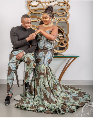 Lady Wears Cleavage-Baring Outfit In Pre-Wedding Pictures With Her Man