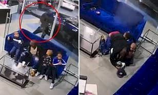 Shocking moment dad is shot as he shields his three kids from gunman who opened fire at car dealership in NYC