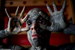 French primary school teacher who spent £35k covering his body in tattoos is banned from kindergarten because he gives children nightmares (photos)